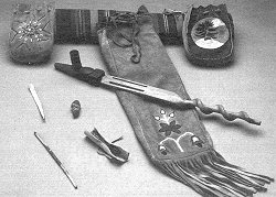 Elements for a Pipe Ceremony: the sacred pipe, carrying pouch, medicine hundles, tobacco role