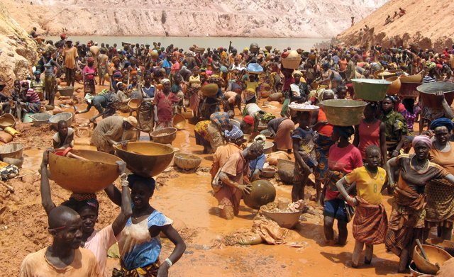 In their struggle for life, many people in the Fatoya region of Guinea, West Africa, work in artisanal or small scale gold mining, some seasonally, some full-time. Miners average .12 grams of gold per day for which they earn US$2. Women make up 50 to 70 percent of the workers and children 10 to 20 percent. An estimated 13 to 20 million men, women, and children in more than 50 developing countries are directly engaged in artisanal mining. /Credit: Development and Peace./
